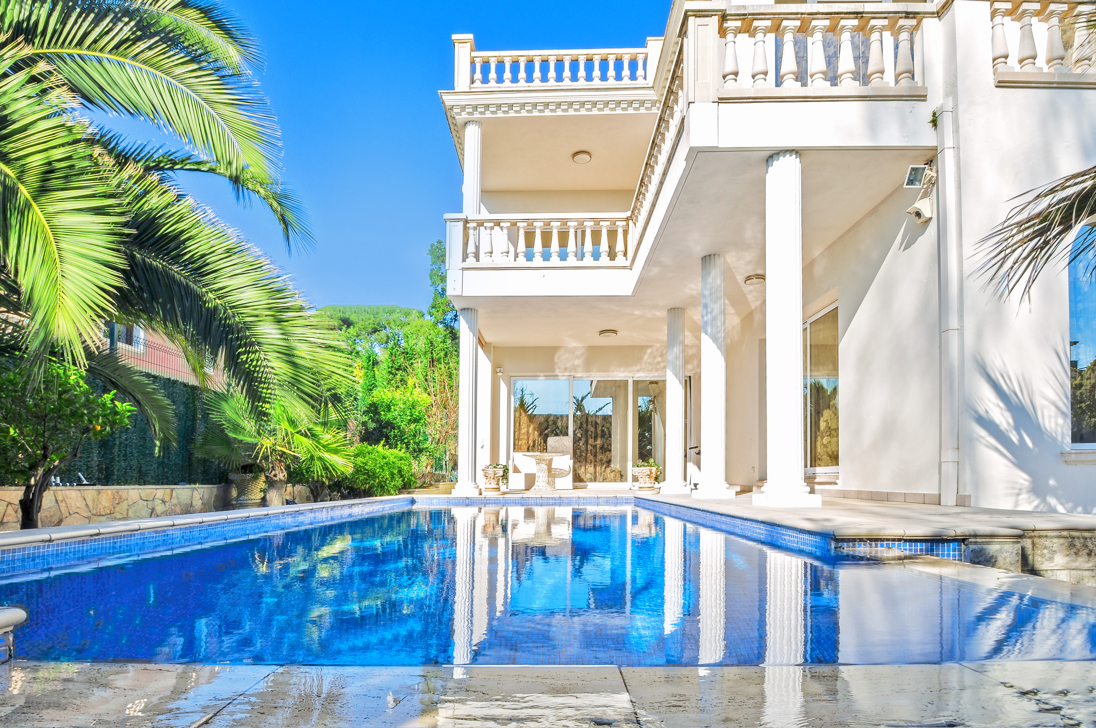 Luxury white house with swimming pool